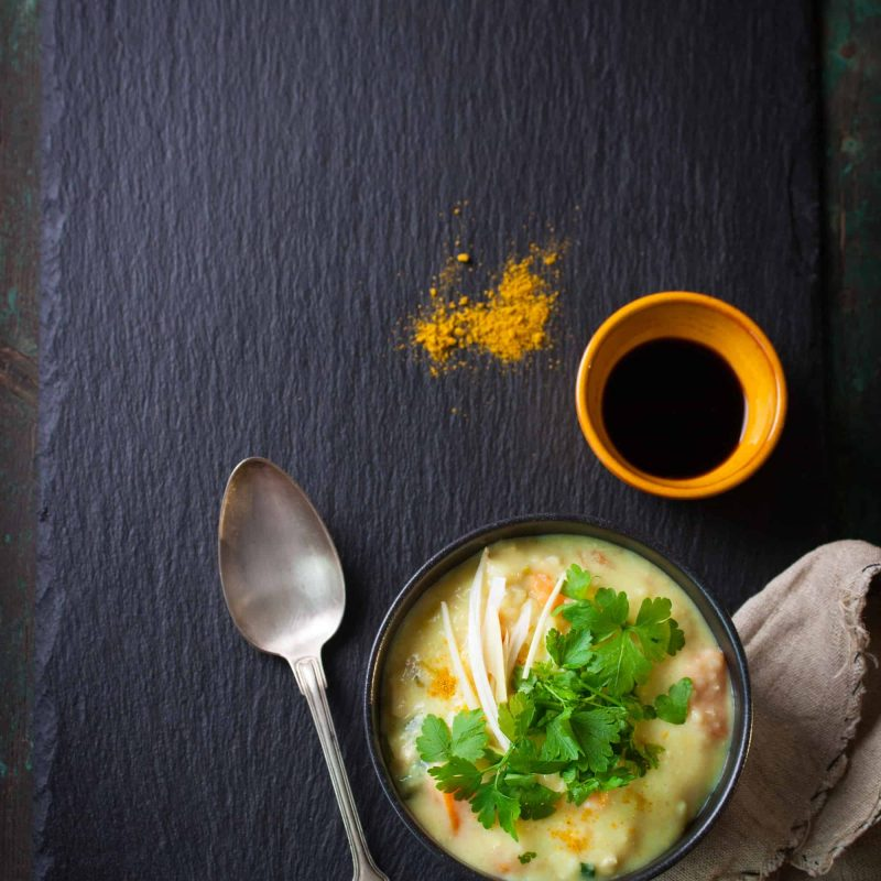 Tasty homemade curry soup with chicken and vegetables, top view with copy space